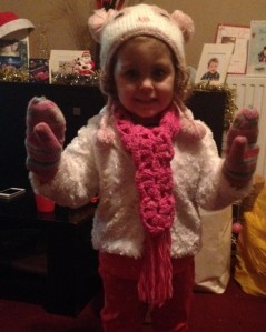 My niece is a little cutie. I crocheted her a scarf out of hot pink malabrigo.