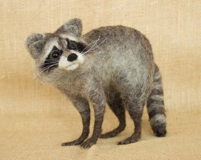 Cute raccoon felted toy